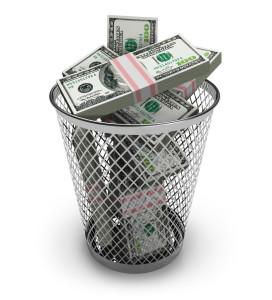 Dollars in the trash bin