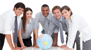 Portrait of business team around a terrestrial globe