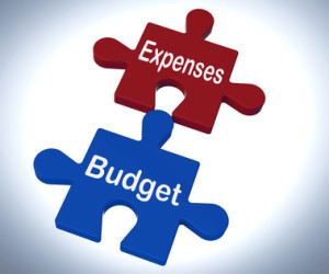 Expenses Budget Puzzle Showing Company Bookkeeping And Balance
