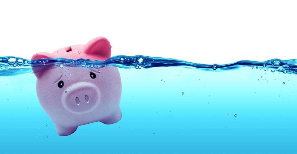 Tirelire cochon rose triste sous l'eau se noie, Comment éviter la faillite, Comment eviter la faillite